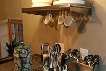 Kitchen island has all your dishes and silverware at hand.