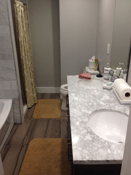 Shared bathroom with separate soaking tub and shower.