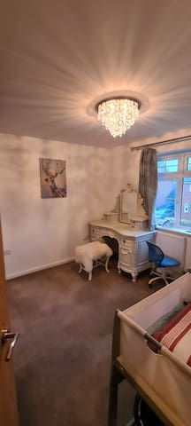 Dressing and make up room with baby cot