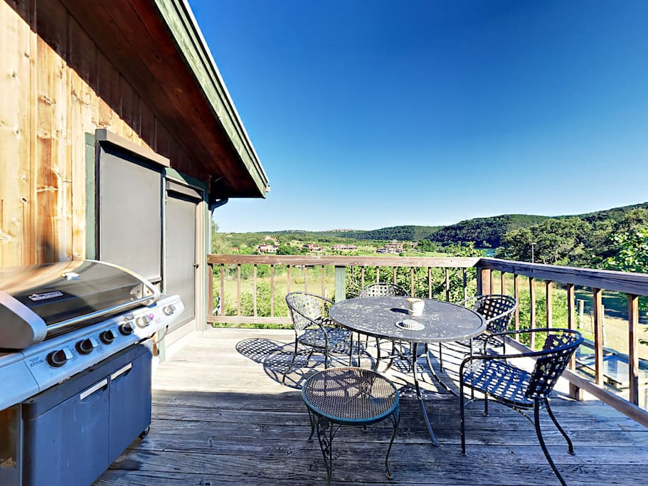 The patio is outfitted with a gas grill and round metal table with 4 chairs