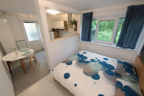 Comfortable double bed with a garden view.