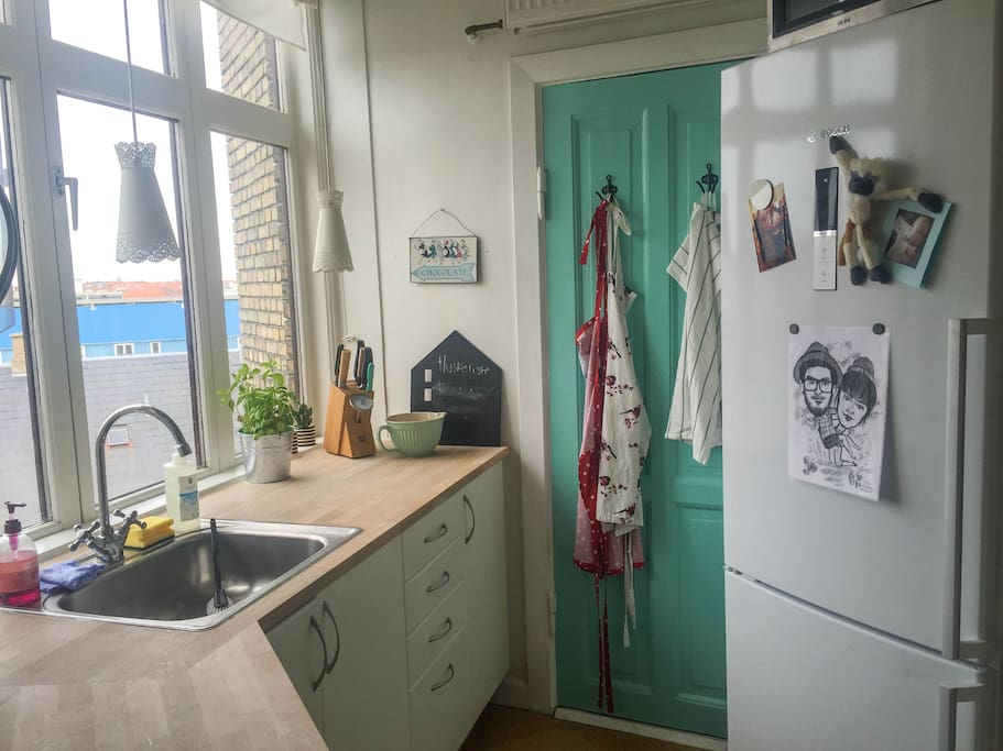 Old school Copenhagen-kitchen, with  a view over the skyline.