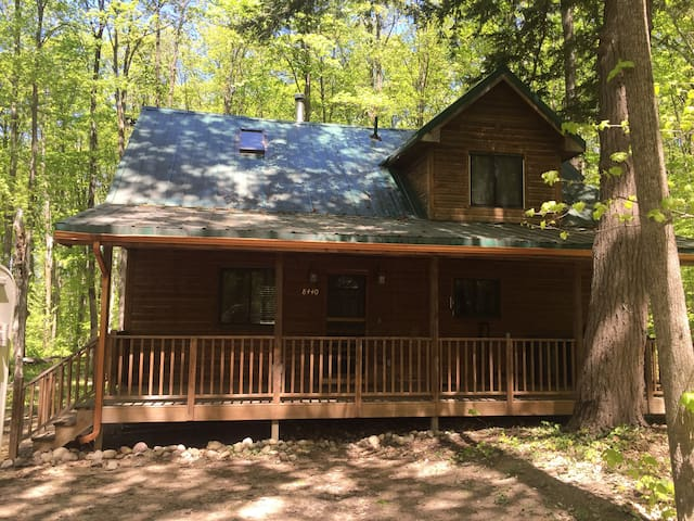 CABIN IN THE WOODS NESTLED ON 15 WOODED ACRES.