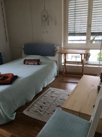 Bedroom for one person, table and chair