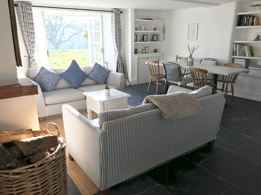 Lovely open plan living and dining area with panoramic views across the countryside and wood burner