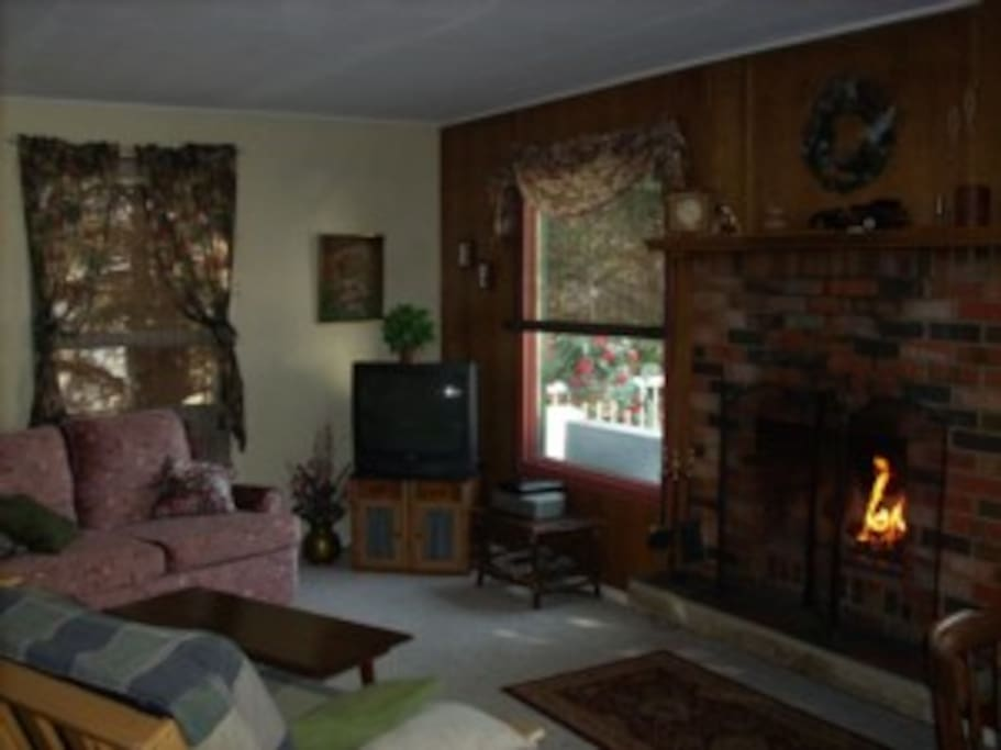Living room has cable/wifi, movies, games and of course a real wood-burning fireplace! Build a puzzle, play a game on a rainy  day while the fire crackles.