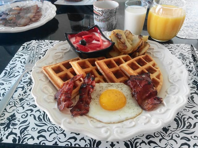 Belgian waffles, bacon, and eggs.
