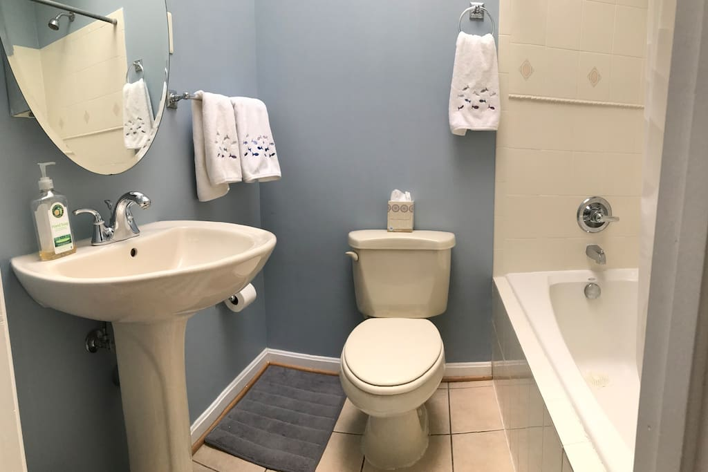 The upstairs bath is stocked with towels, shampoo, and basic items.