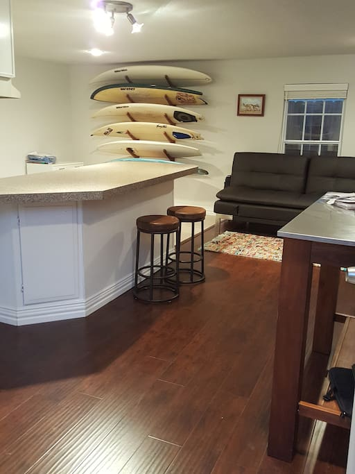 Open concept living/ dining/ kitchen/ work area. Surfboards because we miss Hawaii : )