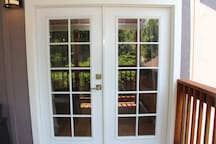 Double doors leading out to your private deck