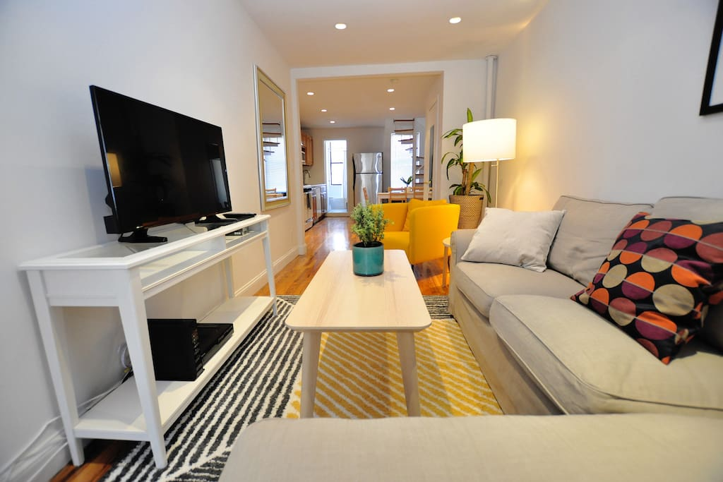Relax in style in the newly furnished living room of our duplex two bedroom apartment.