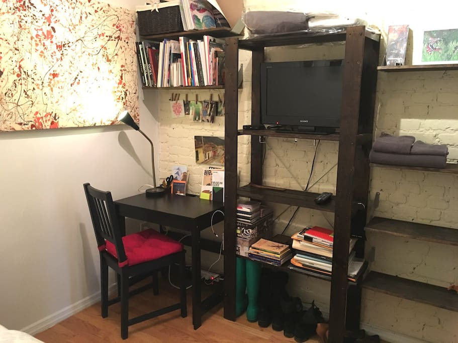 A desk to manage & charge your computer & phone, shelfs for personal items