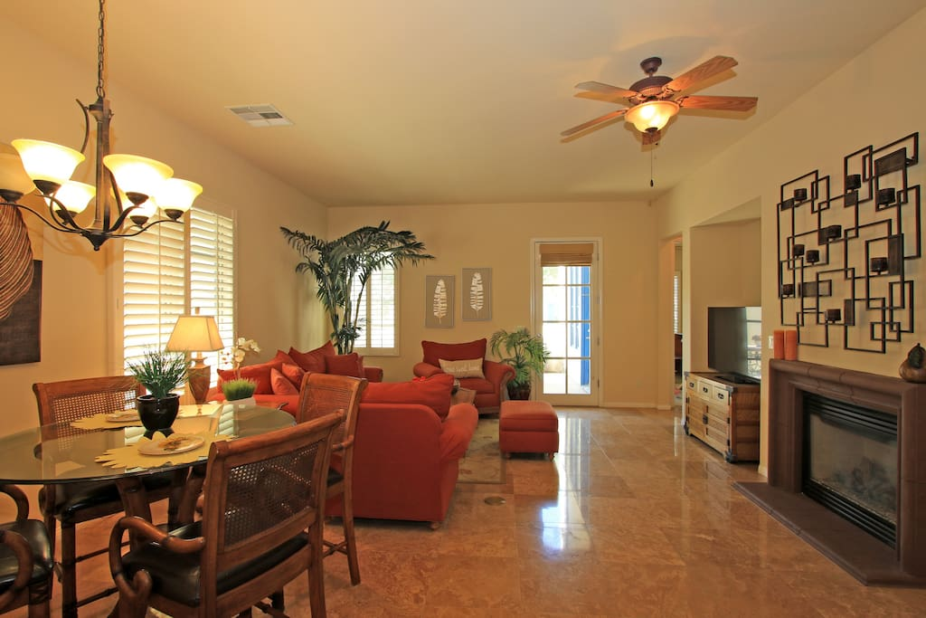 Gas fireplace, dining table, flat screen TV and couches