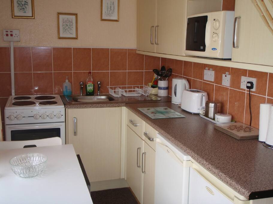 The Kitchen with Oven, Hob, Grill, Fridge, Freezer, Microwave, Kettle, Toaster, Pots, Pans, Crockery, Cutlery & Glasses