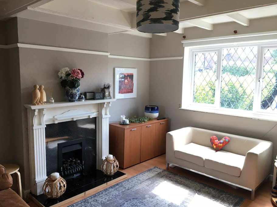 Lovely bright and sunny living area with a fireplace, TV and comfortable coaches to relax on.