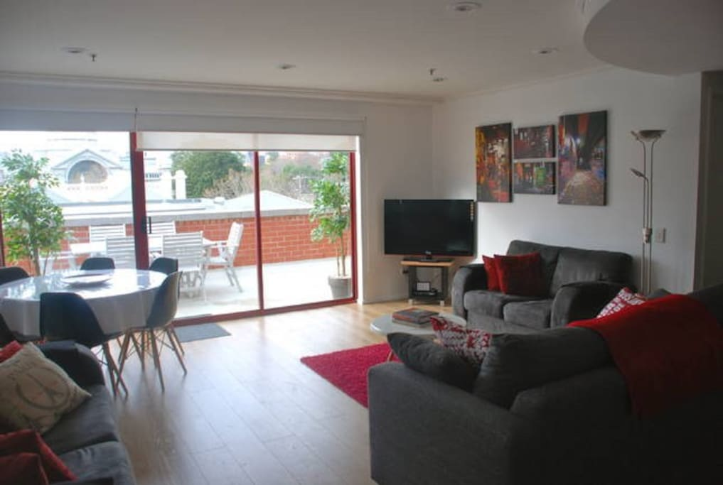 Spacious and light filled living and dining area opening out to a large wrap around balcony.
