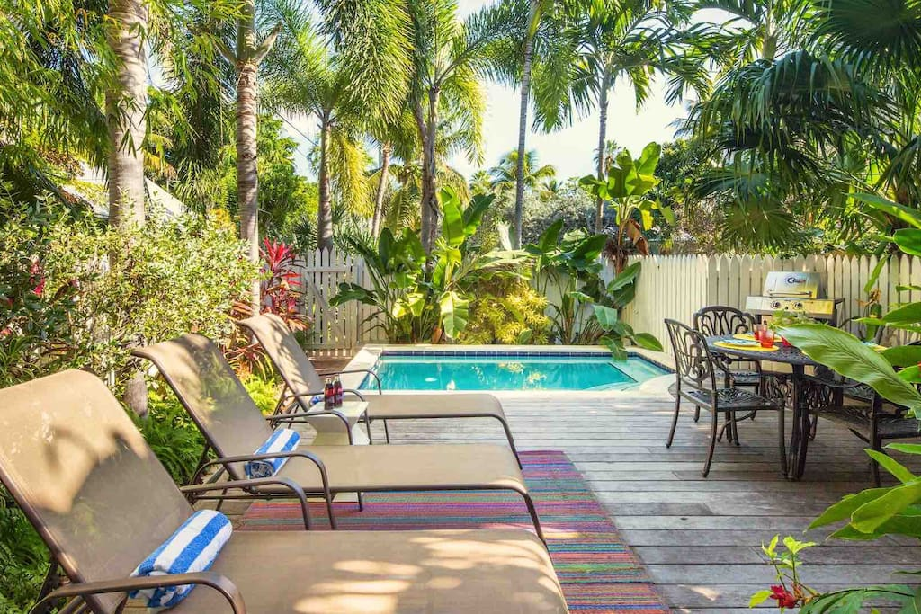 The private pool area is fully fenced for privacy and surrounded by lush tropical greenery...