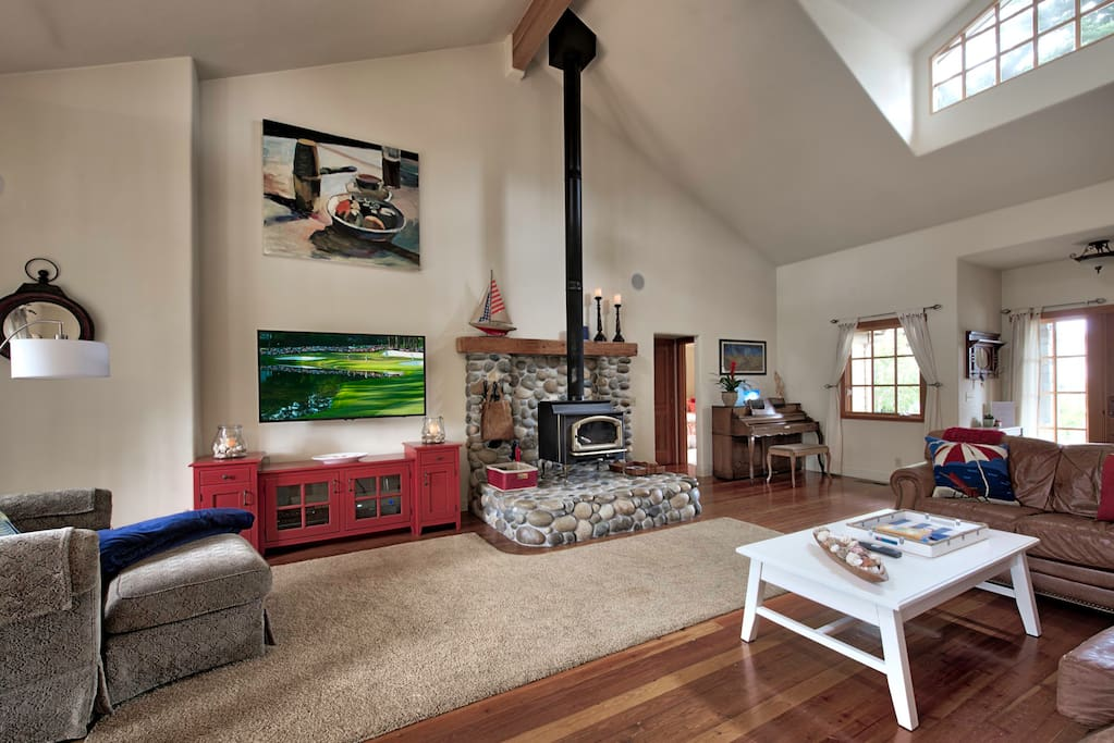 Great Room has comfortable leather couches, a wood stove and a 60-inch HDTV.