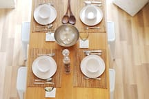 Full dining table with crockery and cutlery
