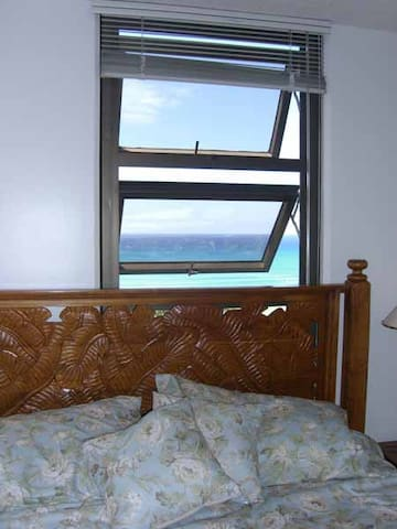 Bedroom window looks toward ocean.