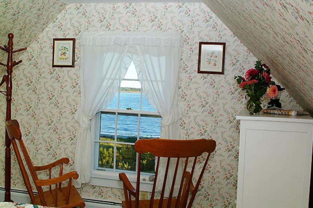We call this the room at the top, it is on the third floor of the 1820's farmhouse, from this room you can see and hear the surf crashing on our private sandy beach. It has a queen sized bed and large private bath with a claw foot bath tub and shower looking over the meadows and gardens.