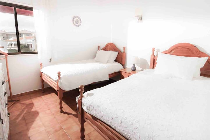 Second bedroom with two comfortable single beds.