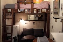 Loft bed with ladder. Love seat sofa bed can transform into additional sleeping area on the floor. Mini refrigerator.