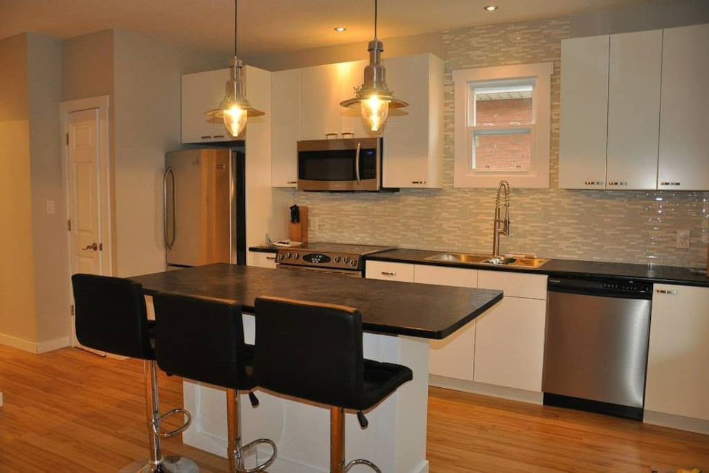 Open concept kitchen/living/dining.