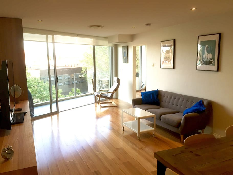 Sunny lounge room opening out to balcony. Solid Australian Blackbutt floors.