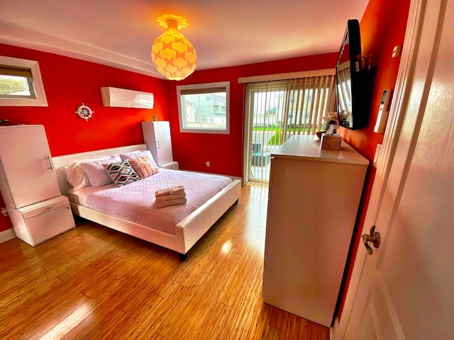 Master bedroom with queen bed. Mirror closet and ample storage and luggage rack. TV with Roku.
