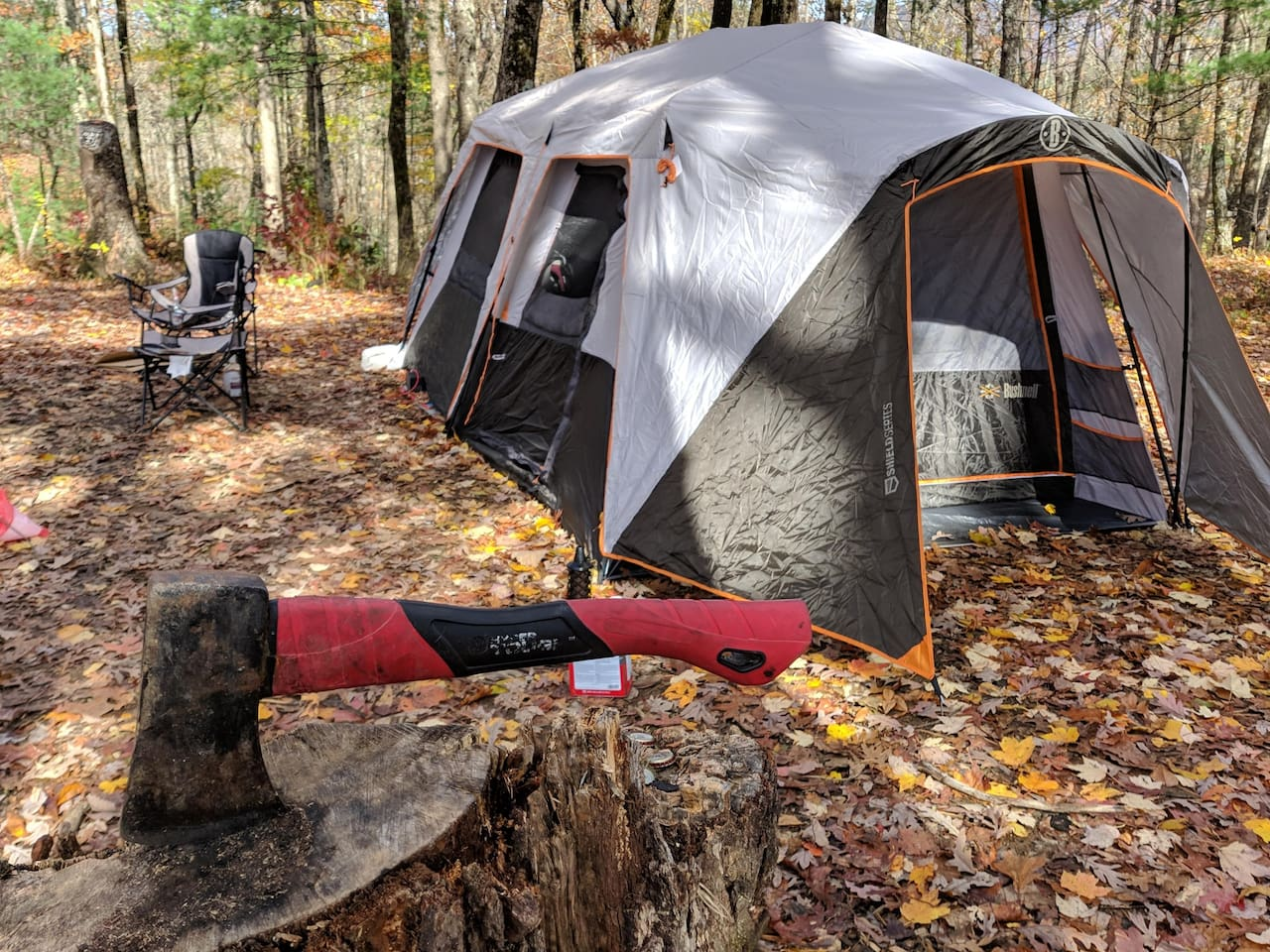 15'x9' Bushnell tent with two exterior doors and wind shield.
