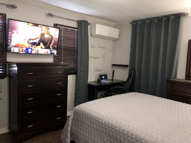 Relax in this tranquil bedroom while watching a movie in bed.  You can also get some work done at the computer desk .