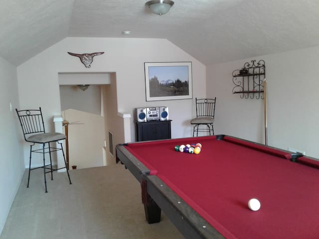 Upstairs pool room. Regular sized pool cues available along with one short pool cue for certain tight shots.