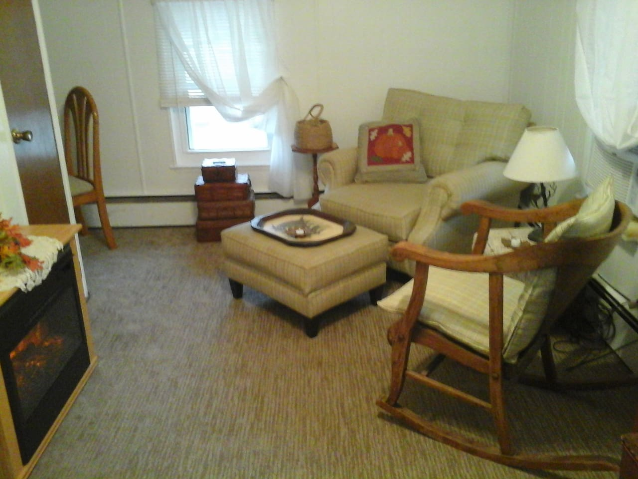 Living room area has electric fireplace to keep things cozy. Also a desk area if needed.