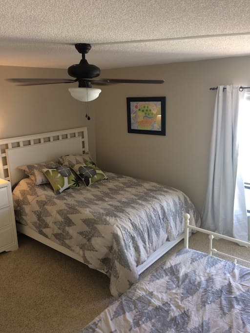 The second bedroom is spacious enough for a queen and a double sized day bed with trundle and has a very large closet