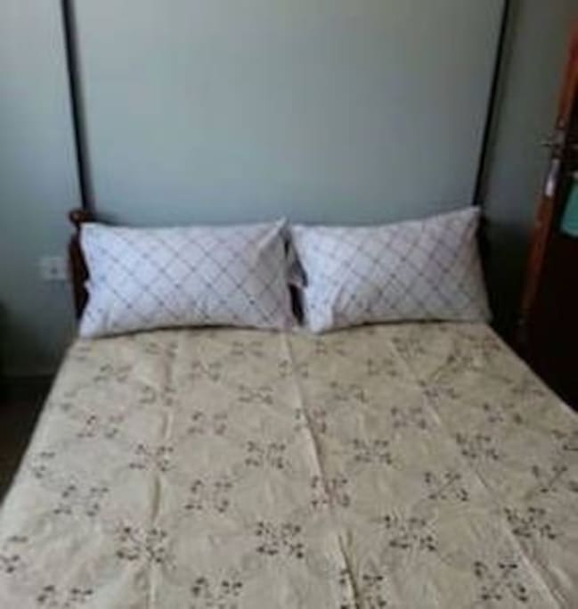4.5ft by 6ft beds, clean & warm beddings, a small wardrobe, telephone extension, and a reading table