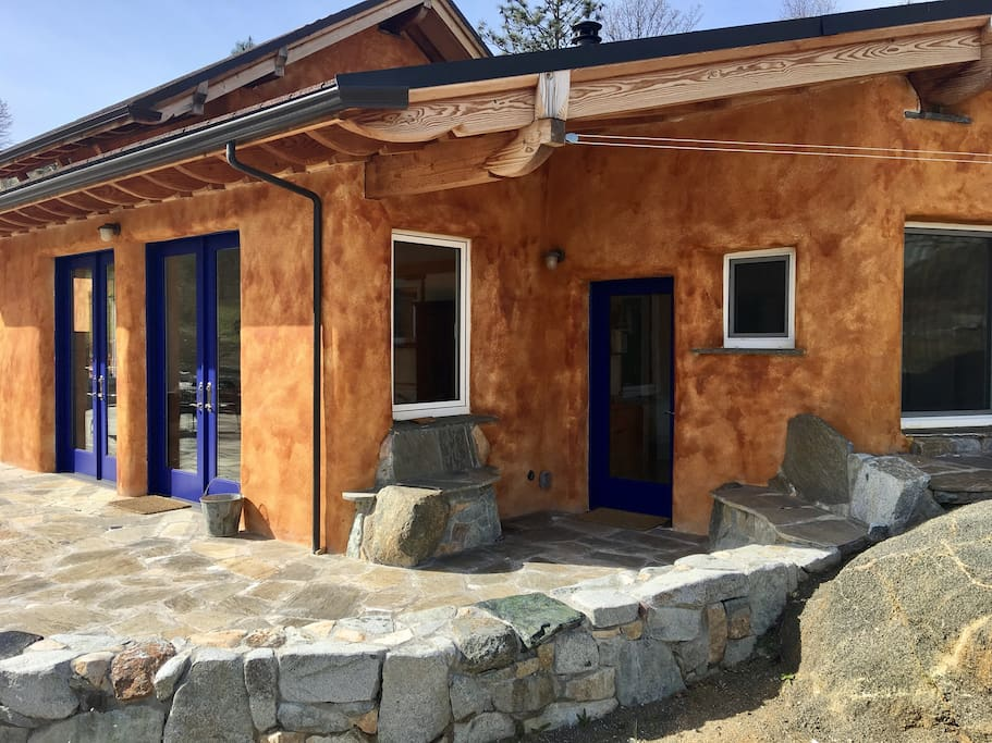 The Stone Villa is made of thick concrete walls which help the home stay warm in the Winter and cool in the Summer.  The home features both passive and active solar.
