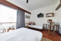 single sofá- bed, dining area , flat screen tv