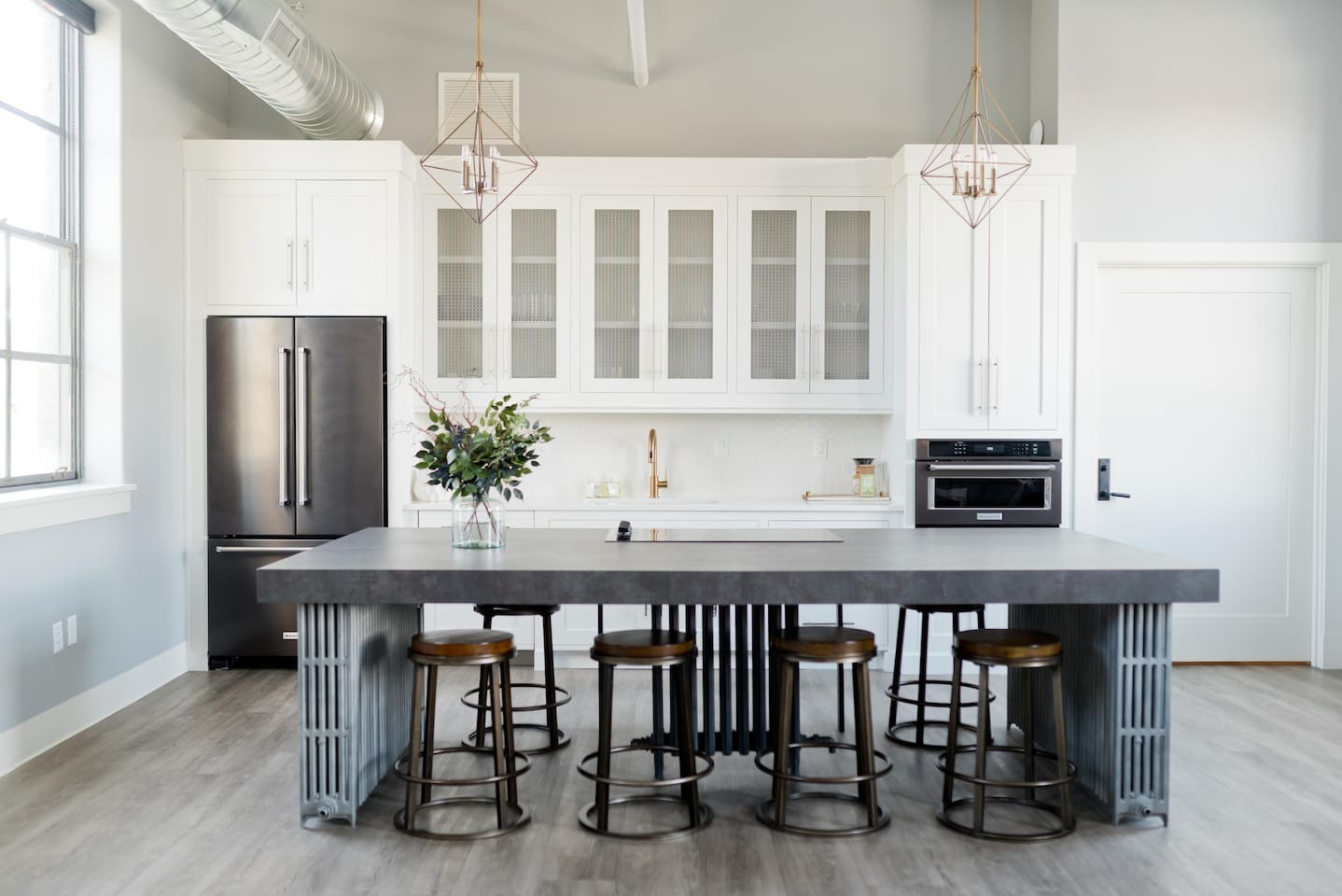 """The South Flat provides comfortable space for dining, cooking and enough lounge space for guests while enjoying a 65"""" smart TV. This gathering space provides a comfortable place to cook a meal, play games, work on a project or engage in conversation."""