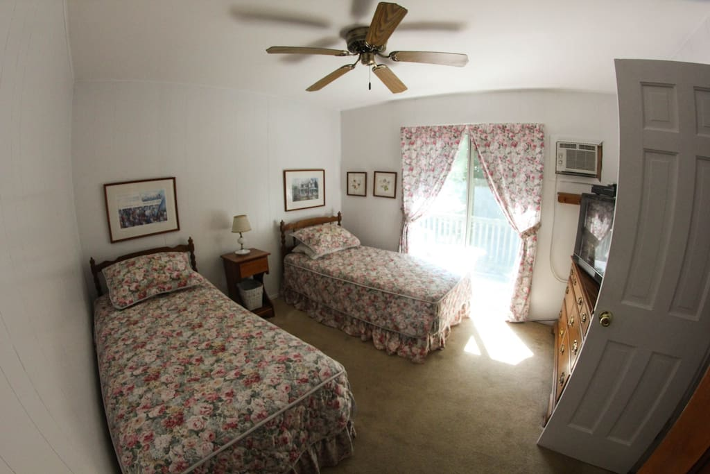 Twin bed room: Ceiling fan, private deck, Small closet AC, Direct TV.