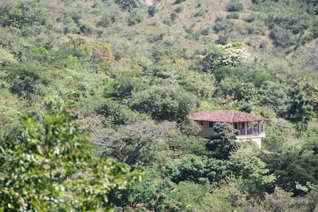 Tropical Wildlife Sanctuary with Private House