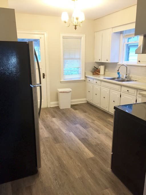 Bright spacious kitchen with updated appliances and walkout to covered porch