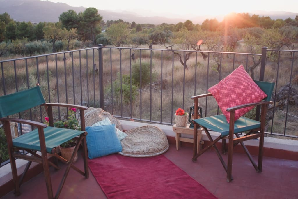 Finca Collita roof-terrace with sunset over the mountains.