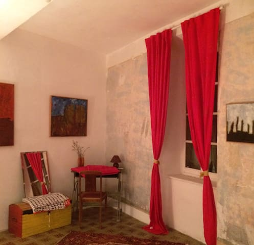 A gallery, red room, enjoy art and home comfort.