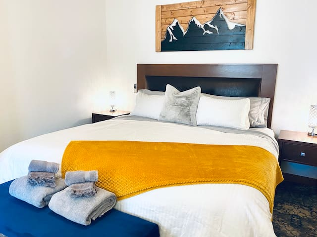 Enjoy the King bed w/memory foam mattress, 600 thread count cotton sheets, pillow topper and custom mountain art to inspire your dreams.