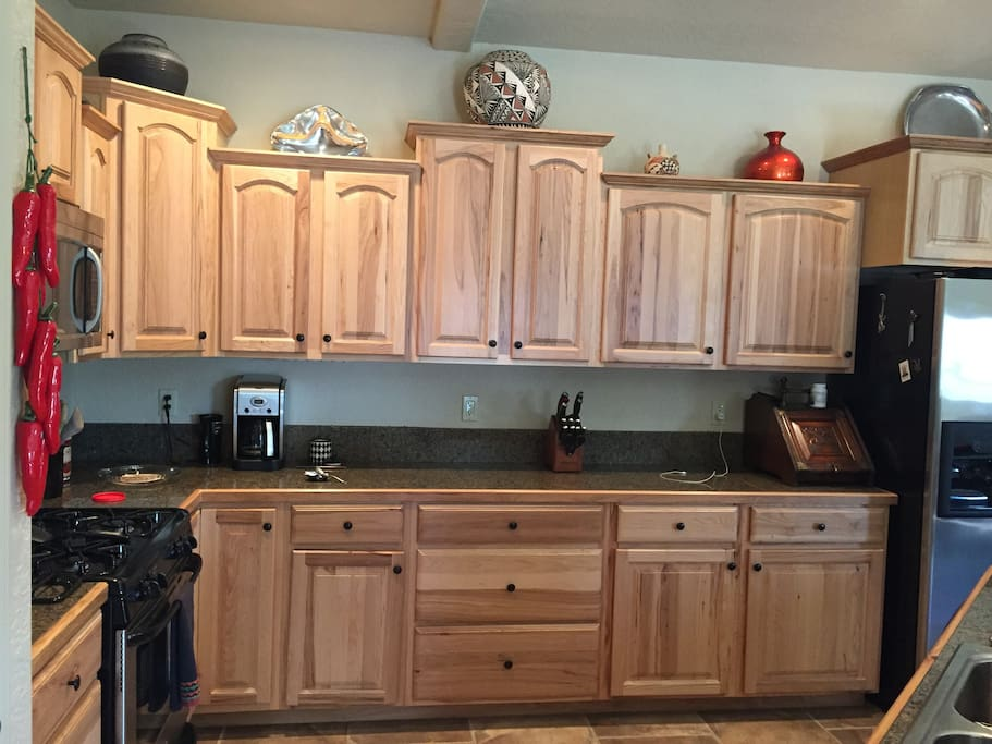 Fully stocked chef's kitchen.