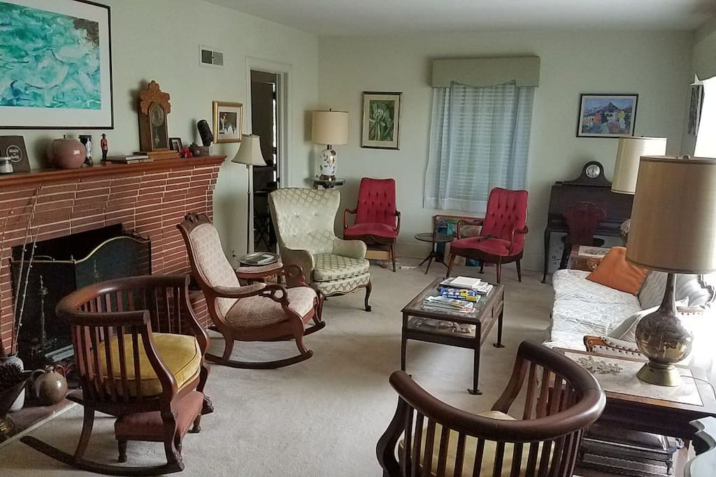 view of sitting room from front door showing door to kitchen