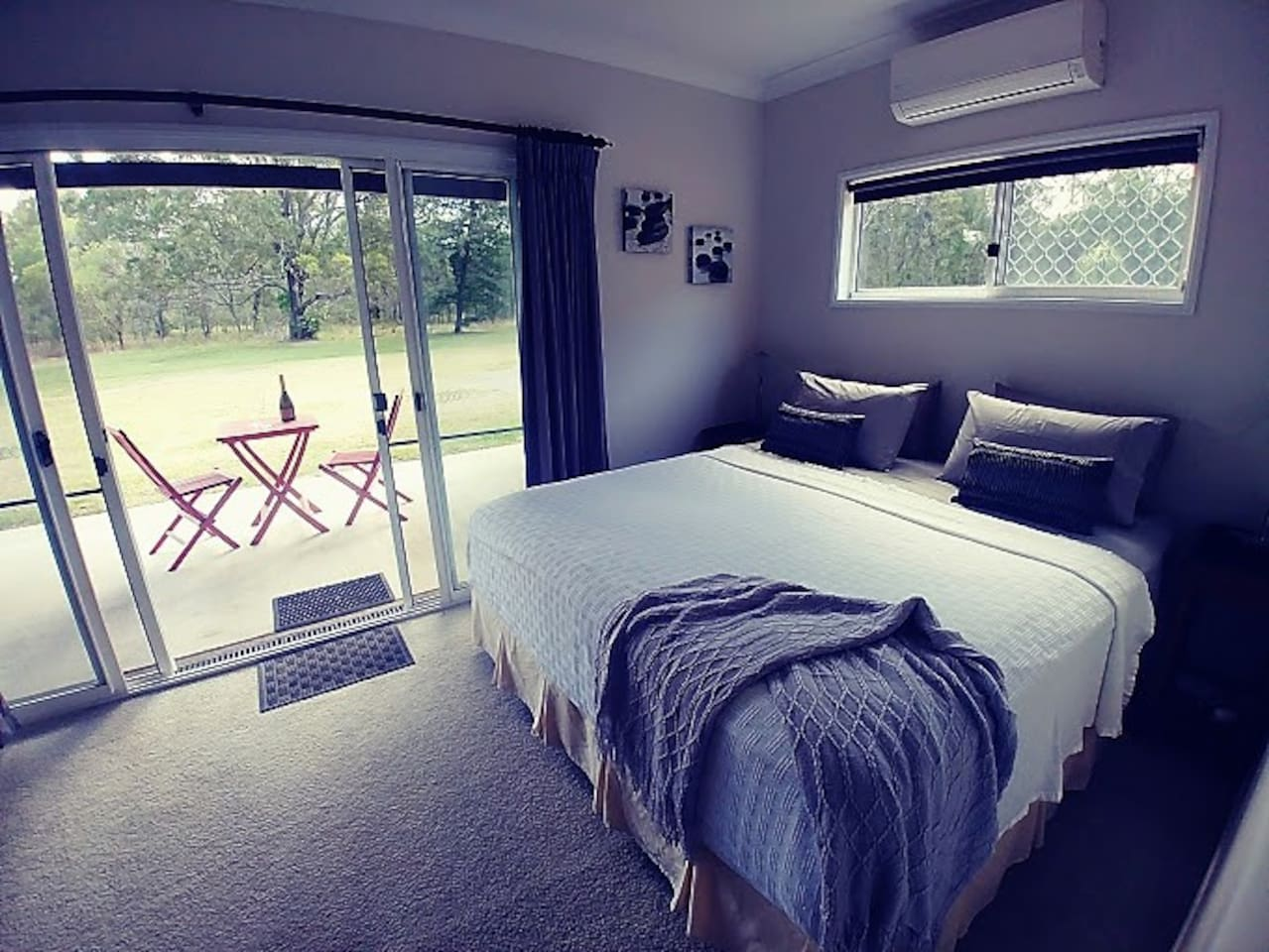 Luxurious Buckingham king size bed, air conditioned with direct access to patio