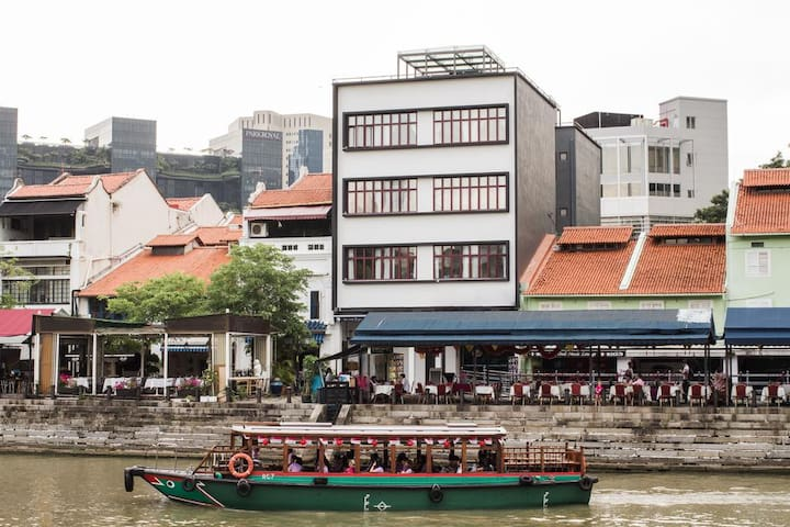 Our RiverView Heritage Apartments along Boat Quay in the Day