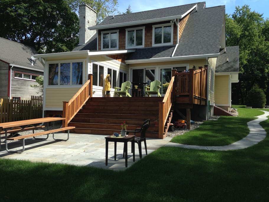 Back of house facing Little Swartswood Lake; Deck w/grill;patio w/table and firepit.